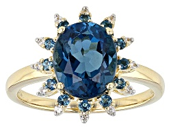 DEB011<br>2.77ctw Oval And Round London Blue Topaz With .10ctw Round White Zircon 10k Yellow Gold Ri
